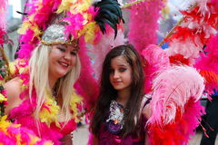 Gay Pride Rally on 23rd May 2015. Woman and girl in costume colourful feathers at Gay Pride march and rally in Birmingham England Stock Photography