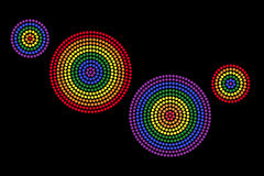 Gay radial dot patterns on black background Stock Images