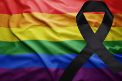 Gay rainbow flag with black mourning ribbon. Waving gay rainbow flag with black mourning ribbon Royalty Free Stock Photography