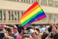 Gay rainbow flag at Montreal gay pride parade. Montreal, CANADA - 20 August 2017: Gay rainbow flag at Montreal gay pride parade with blurred spectators in the stock image