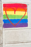 Gay rainbow flag and red heart Royalty Free Stock Photos