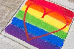 Gay rainbow flag and red heart Stock Photos