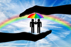 Gay rights notion. Icons of two gays with a rainbow umbrella in hand on a background of iridescent sky Royalty Free Stock Image
