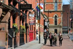 Gay Village in Manchester. MANCHESTER, UK - APRIL 23: People visit famous Gay Village on April 23, 2013 in Manchester, UK. Gay Village is one of oldest and Stock Image
