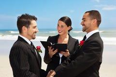 Gay wedding. Gay couple getting married on a beach Stock Photos