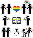 Gay women  falling in love and engagement icons set with rainbow element Royalty Free Stock Images