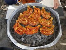 Gay Yangchar-grilled marinated chicken sold on the street of Bangkok royalty free stock image