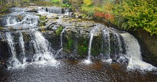Gayle Beck Waterfalls in Hawes. Yorkshire Dales National Park North of England. Shot with fast shutter speed, Autumn colours and Landscape orientation stock images