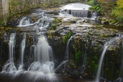 Gayle Beck Waterfalls in Hawes. Yorkshire Dales National Park North of England. Shot with slow shutter speed moving water blur and highlighting autumn colours royalty free stock photos