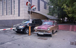 GAZ-21 and LC-200 Stock Image