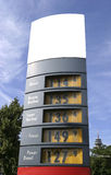 Gaz price display. Of a fuel station with blank space in front of a clear summer sky in the city stock images