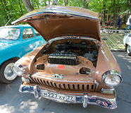 The GAZ-21 Volga car with an open motor compartment on show of retro cars. The GAZ-21 Volga car with an open motor compartment on show of the retro cars Royalty Free Stock Photos