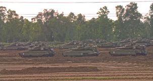 Gaza, April 6th 2019. IDF tanks lined up in combat formation near the border. Gaza, April 6th 2019. IDF tanks and APC`s lined up in combat formation near the stock footage