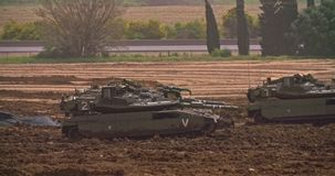 Gaza, March 30, 2019. IDF tanks lined up in combat formation near the border. Gaza border, March 30, 2019. IDF tanks and APC`s lined up in combat formation near stock video