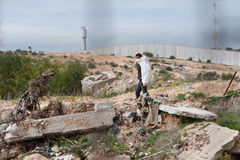 Gaza Border Zone. EREZ CHECKPOINT, OCCUPIED PALESTINIAN TERRITORIES - JANUARY 17: Palestinian workers scavenge in the 300-meter restricted access zone along the Stock Photo