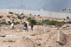 Gaza Border Zone. EREZ CHECKPOINT, OCCUPIED PALESTINIAN TERRITORIES - JANUARY 17: Palestinian workers scavenge in the 300-meter restricted access zone along the Stock Images