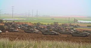 Gaza, March 30, 2019. IDF tanks lined up in combat formation near the border. Gaza border, March 30, 2019. IDF tanks and APC`s lined up in combat formation near stock video footage