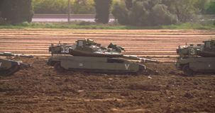Gaza, March 30, 2019. IDF tanks lined up in combat formation near the border. Gaza border, March 30, 2019. IDF tanks and APC`s lined up in combat formation near stock footage