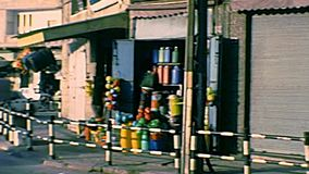 Archival streets of Gaza. GAZA, PALESTINE, ISRAEL - CIRCA 1979: Streets life of Gaza town with palestinian people in cars and local shops. Archival of Israel and stock video footage