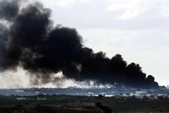 Gaza War. GAZA STRIP - JANUARY 09: Big black smoke over Gaza Strip during Cast Lead operation on January 09 2009.It was a three-week armed conflict in the Gaza Royalty Free Stock Images