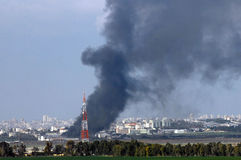 Gaza War. GAZA STRIP - JANUARY 11: Big black smoke over Gaza Strip during Cast Lead operation on January 11 2009.It was a three-week armed conflict in the Gaza Royalty Free Stock Image