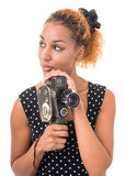 Gaze operator. Portrait of a young woman with a camera in hand, in a retro style Royalty Free Stock Photo