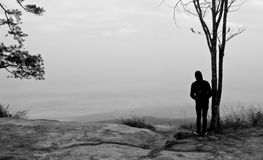Gaze out over. Background of the man standing lonely on the hill Royalty Free Stock Photo