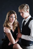 Gaze and touch. Young handsome man looks at pretty woman and touches her hand Royalty Free Stock Photos