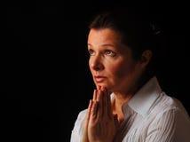 Gaze toward heaven. Beautiful woman gazing up to heaven with hands folded in prayer Royalty Free Stock Photo