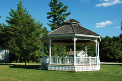 Gazebo. In the summer with bright, blue sky and super green grass stock photos