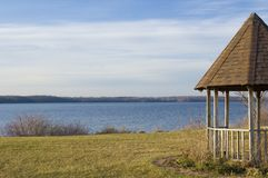 Gazebo. A gazebo standing next to a lake Royalty Free Stock Image