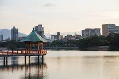 Gazebo. Along the skyline of Ohori Park, Fukuoka, Japan royalty free stock image