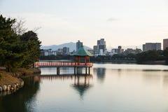 Gazebo. Along the skyline of Ohori Park, Fukuoka, Japan stock photography