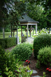 Gazebo amongst the Trees. Gazebo amongst surrounding trees and flowers Stock Photo