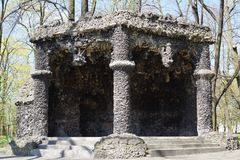 Gazebo with cement and travertine - a replica of the famous grotto of lava - city park Royalty Free Stock Photo
