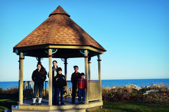 Gazebo with Children by Lake royalty free stock images