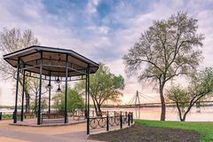 Gazebo Close to the River. Gazebo with wooden benches, in the Naltalka park of Kiev, Ukraine, near the Dnieper river, during a cloudy spring morning Royalty Free Stock Images