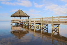 Gazebo, dock, blue sky and clouds. Public gazebo and dock with blue sky and white clouds over Whale Head Bay off of Currituck Sound on the Outer Banks near royalty free stock image