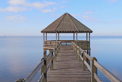 Gazebo and dock over calm sound waters Stock Image