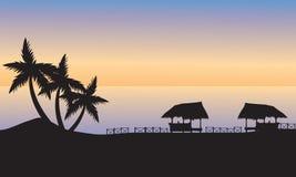 Gazebo en la orilla del océano en la puesta del sol Imágenes de archivo libres de regalías