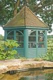 Gazebo beside fish pond in garden. Royalty Free Stock Photography