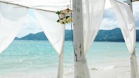 Gazebo with flowers on the beach. Wedding stock video footage