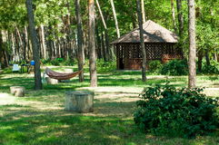 Gazebo in the forest. View of the arbor, hammock in the forest on a summer day Stock Photo