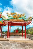 Gazebo with a golden dragon on the roof of Chinese Sangthom Temple of the Goddess of Mercy Shrine in Chaloklum, Ko Pha Ngan, Thail. And Showing the ornate stock photos