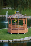 Gazebo on green island Royalty Free Stock Image