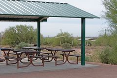 Gazebo with green metal roof and pick nick tables stock image