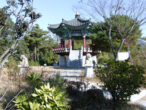 Gazebo. Hexagonal gazebo on stilts in the Oriental style, surrounded by stone statues Royalty Free Stock Images