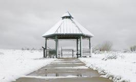 Gazebo i en snöstorm Arkivfoton