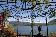 Gazebo on lake Como. Fantastic landscape of lake Como ( Lago di Como called also Lario) seen  from gazebo in historic Garden of Villa Carlotta, Tremezzo Royalty Free Stock Photography