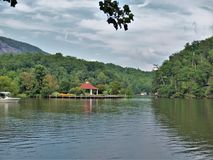 Gazebo at Lake Lure, North Carolina. This 720 acre lake in the town by the same name is fed by the Rocky Broad River and is the number one attraction in the area royalty free stock photo